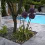Foto vom Pool mit kleinem Garten